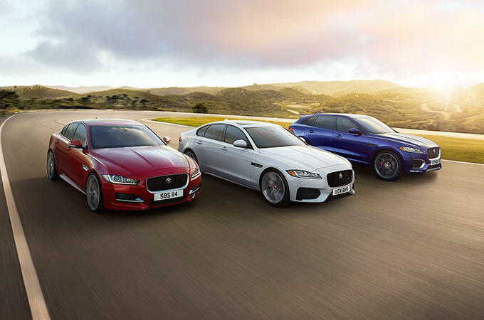Three Jaguar vehicles driving