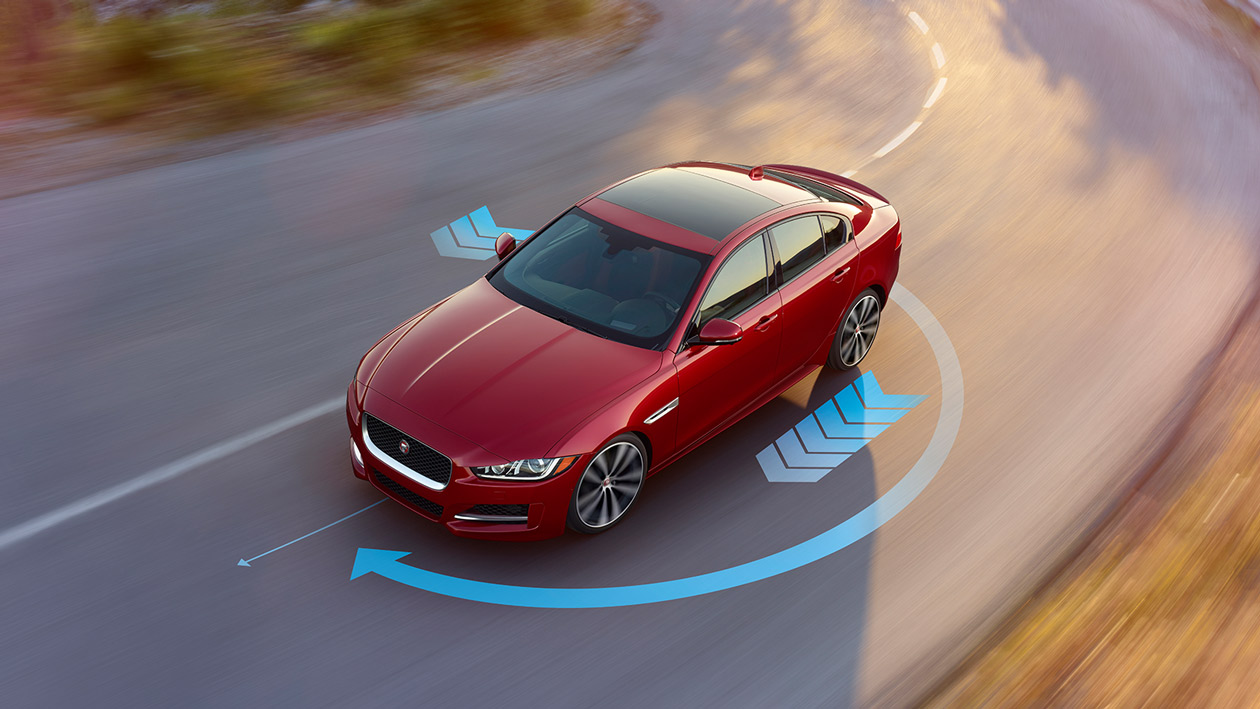 Torque Vectoring, red Jaguar on the road.