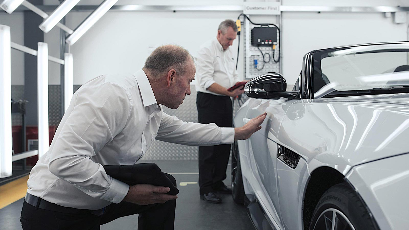 Jaguar engineers inspect the finishing touches of a model.