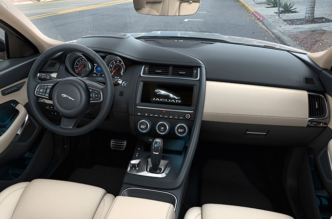 Interior view of E-PACE with cream seats.
