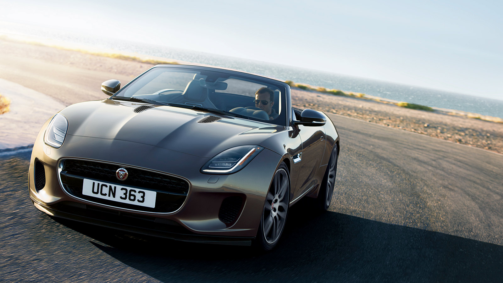 F-TYPE R-Dynamic in Silicon Silver Driving Around Corner