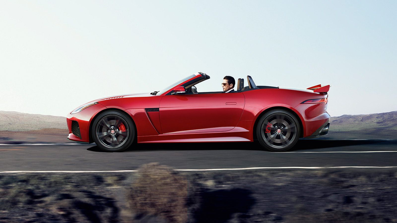 F-TYPE SVR in Caldera Red In-Motion Side View