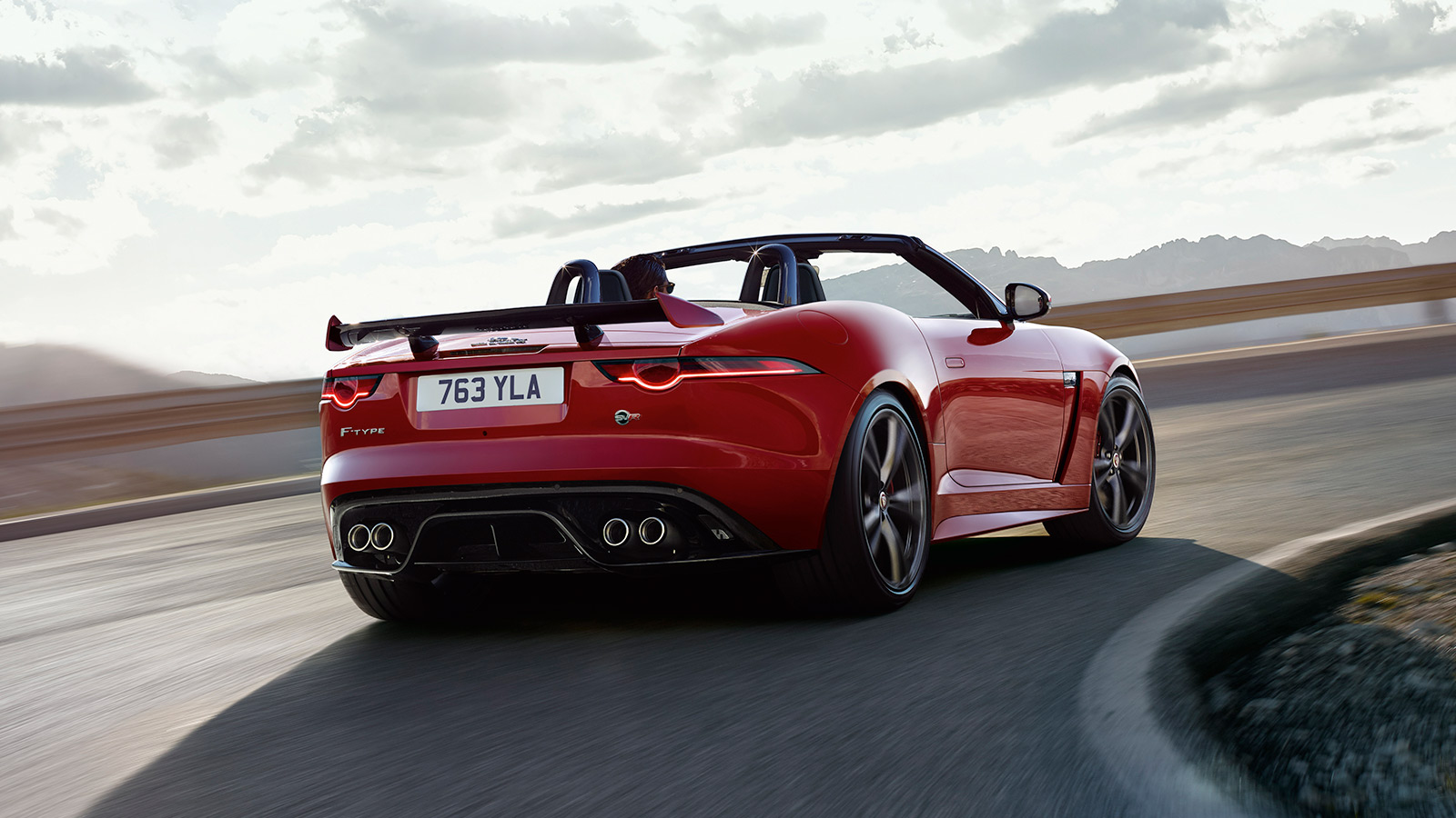 F-TYPE SVR Convertible in Caldera Red Driving Around Corner