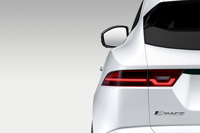 Close-up of white Jaguar taillight.