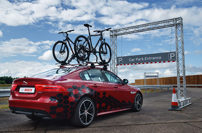 Red XE with bike rack on roof.