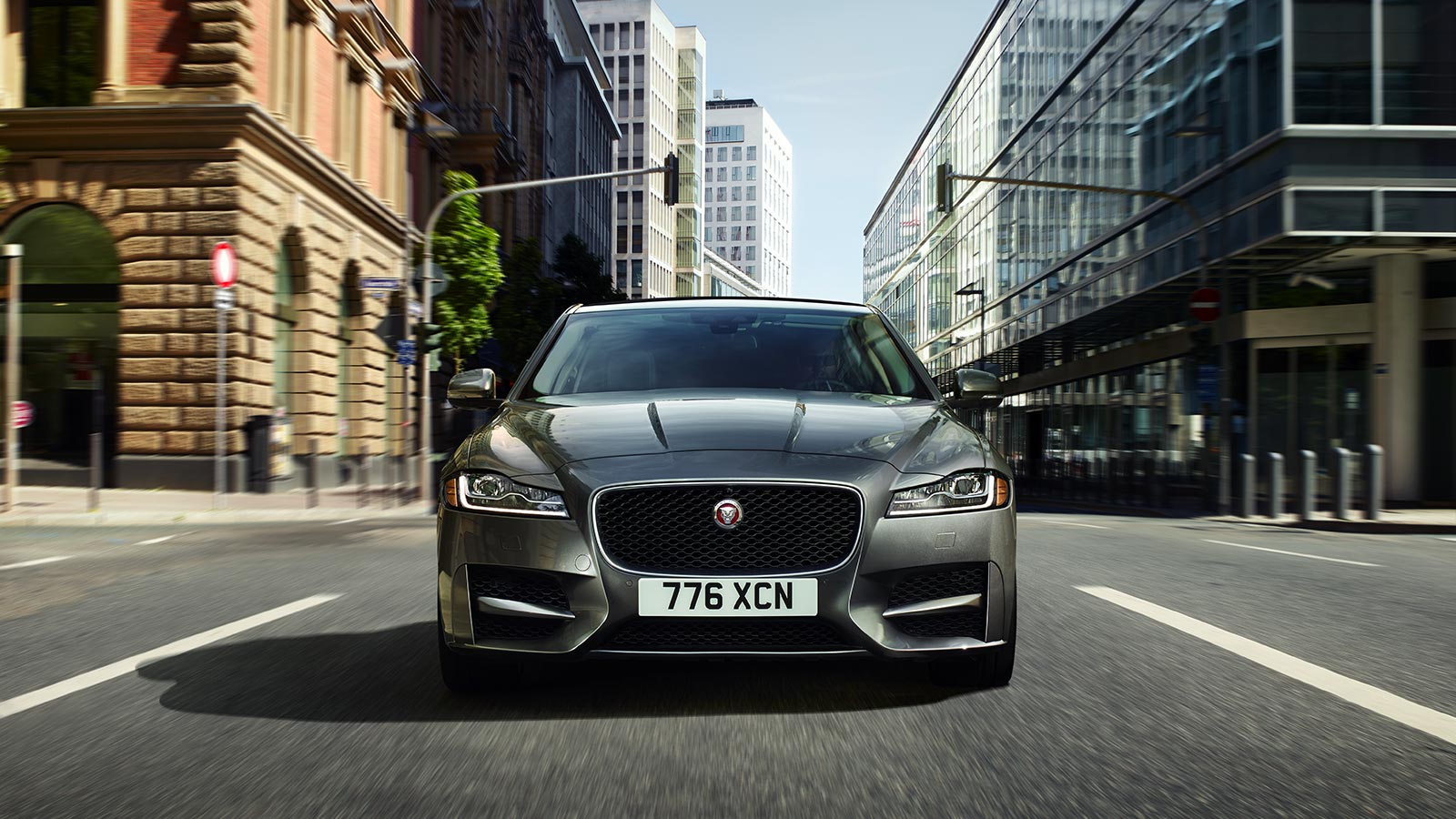 Front view of Jaguar XF driving on-road.
