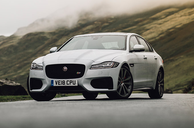 grey jaguar XF, front angle.
