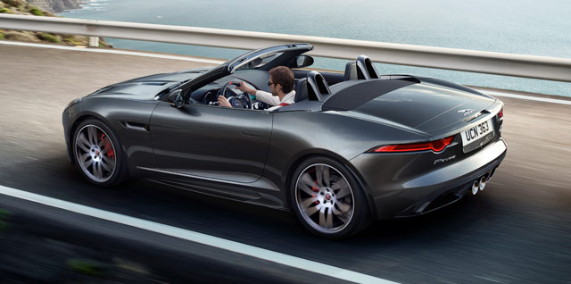 Jaguar F‑TYPE CHEQUERED FLAG CONVERTIBLE parked on a gravelly surface