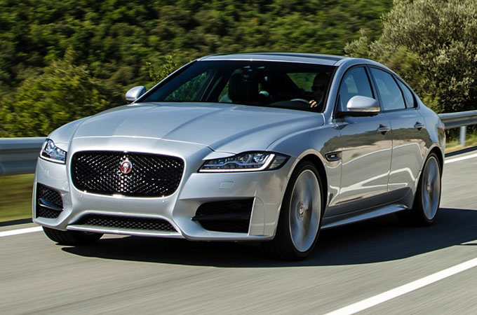 A Jaguar XF driving on a road.