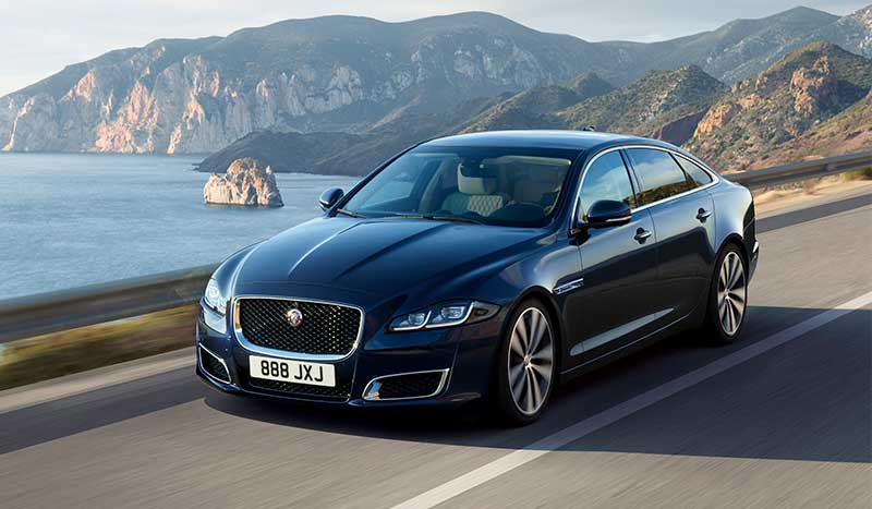 Blue Jaguar XJ driving.