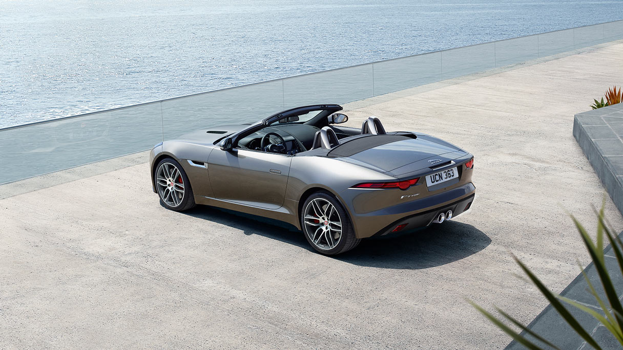 Grey F-TYPE parked on viewpoint.