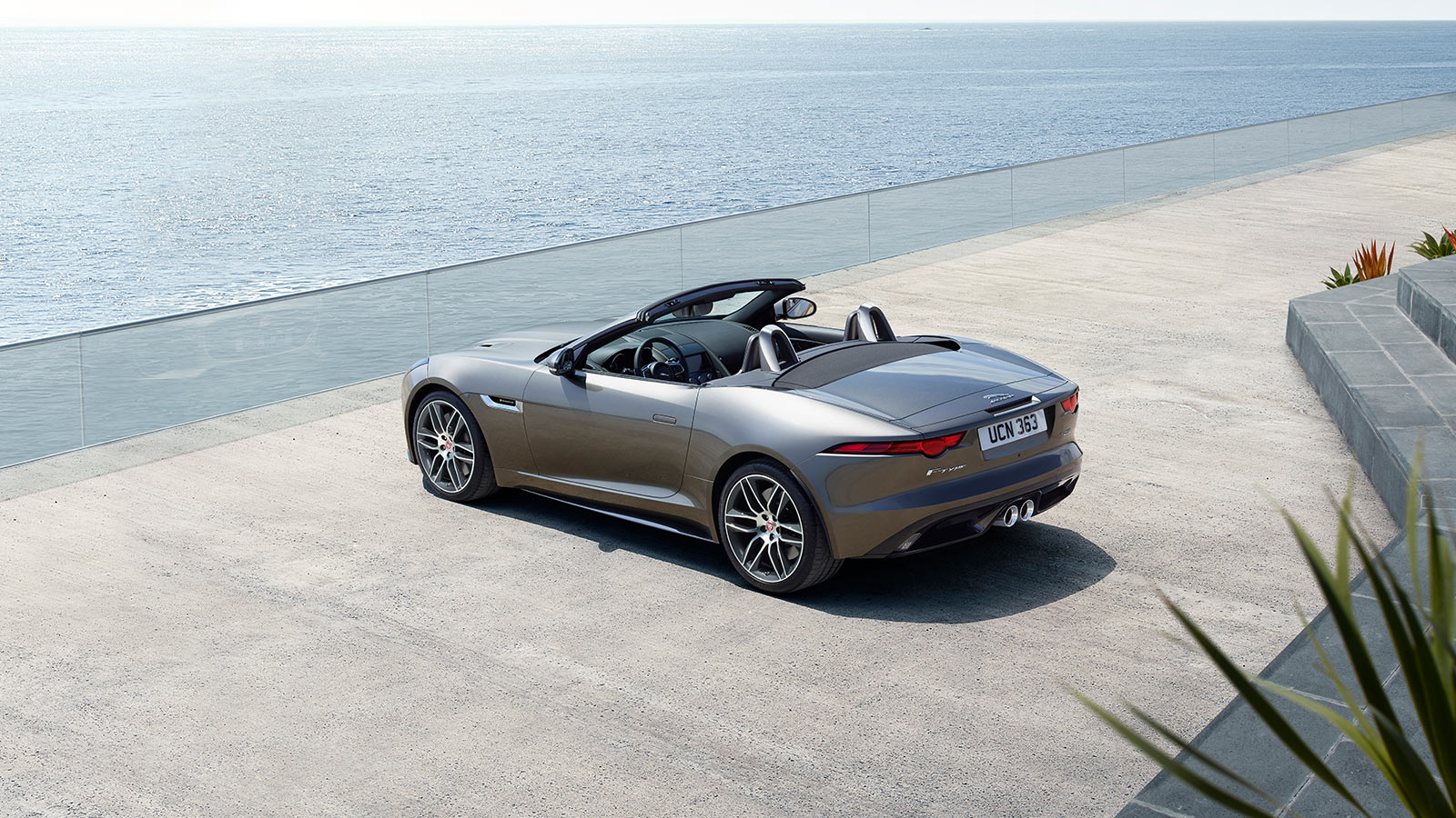 Ownership FTYPE parked on a beach driveway, with sea in front of it.