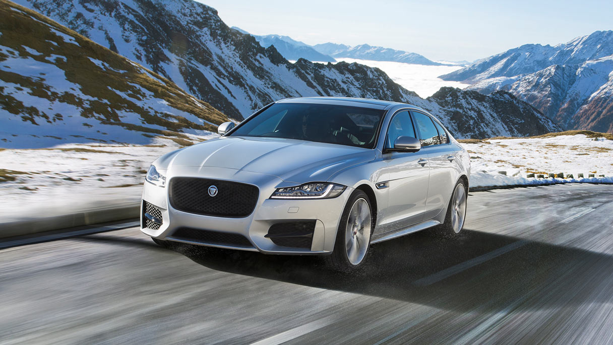 Silver XF driving on mountain.