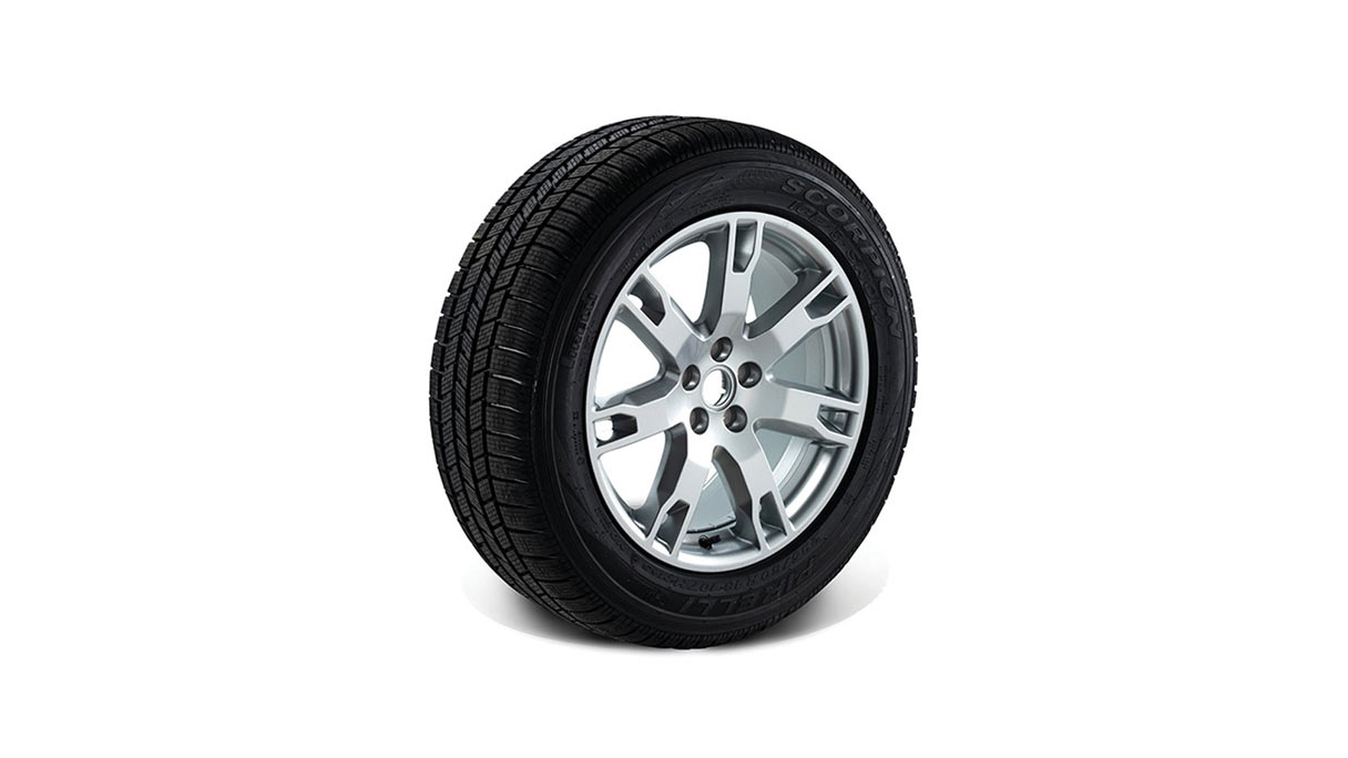 Showcase of JLR Wheel with silver rims and terrain-appropriate tyre.