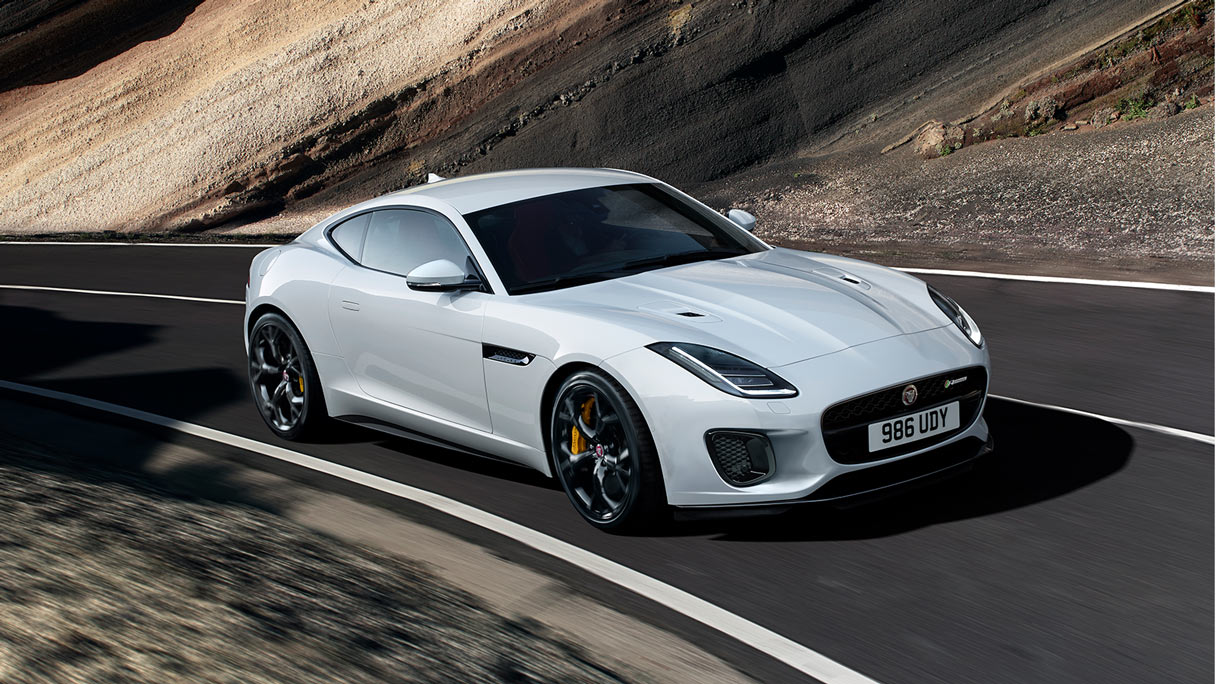 Jaguar FTYPE on a mountain road in motion.
