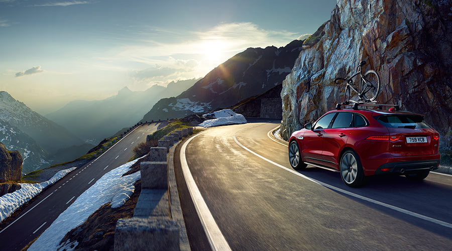 Red Jaguar F-Pace on a mountain road.