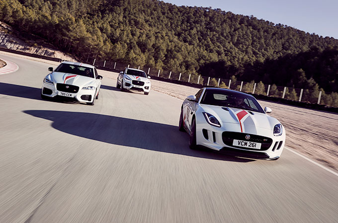 The front view of Jaguar cars in an arrow formation.