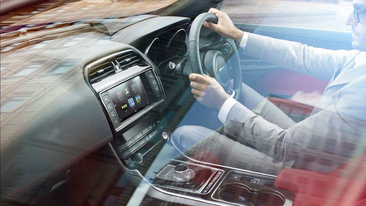 XE Interior with driver on the road.