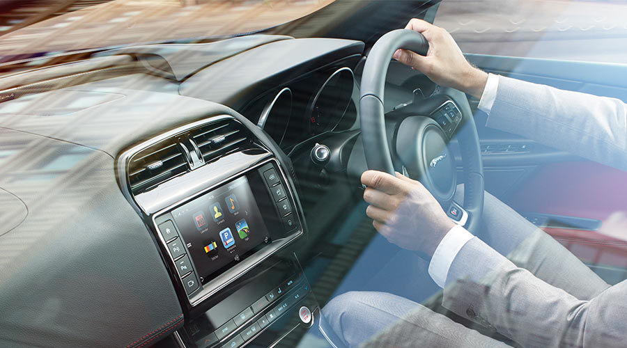 Interior view of man driving XE.