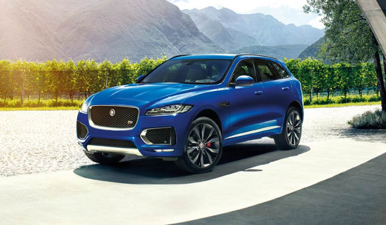 Blue F-PACE parked in rural area.