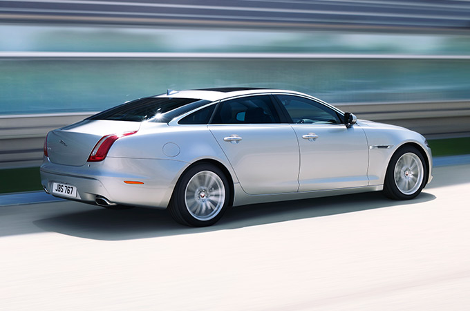 Silver XJ being driven.