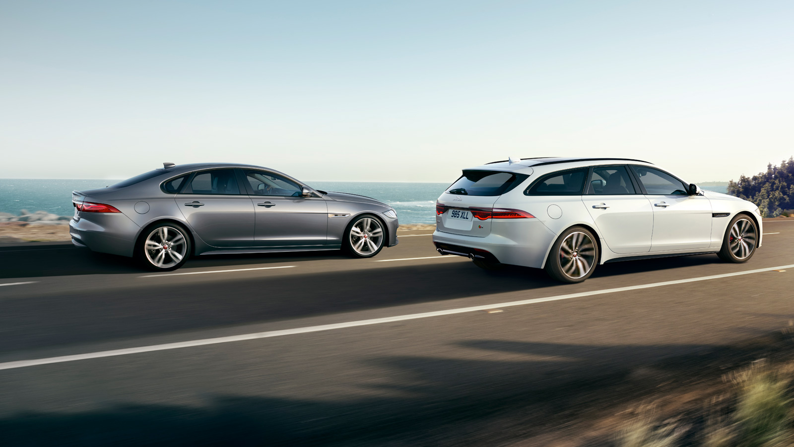 Jaguar XF Driving Along Road