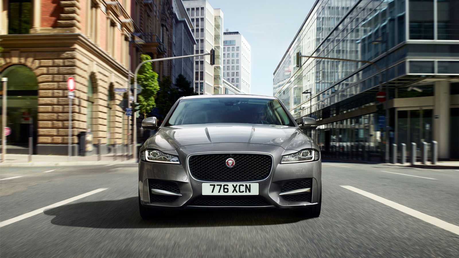Jaguar XF driven on road.