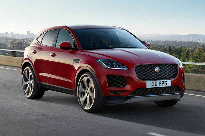 Red E-PACE driving on bridge.