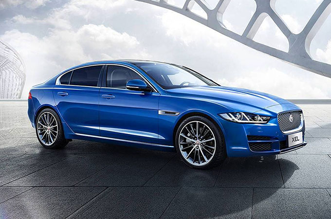 Blue Jaguar XE, parked on a grey and silver background.
