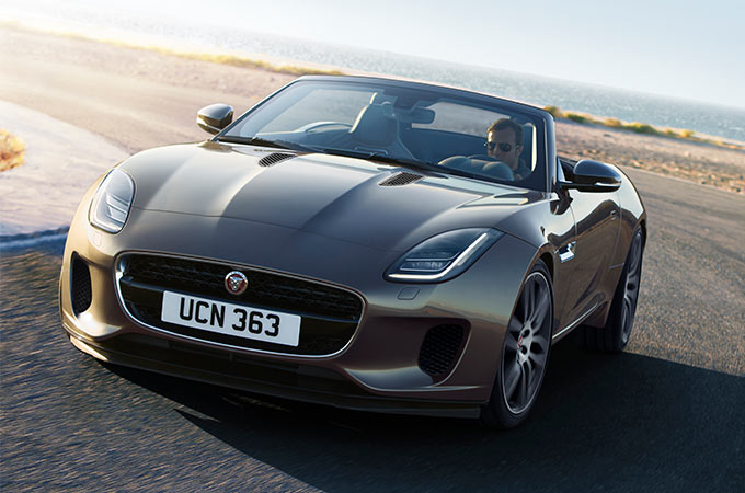 F-TYPE Convertible driving along coastline.