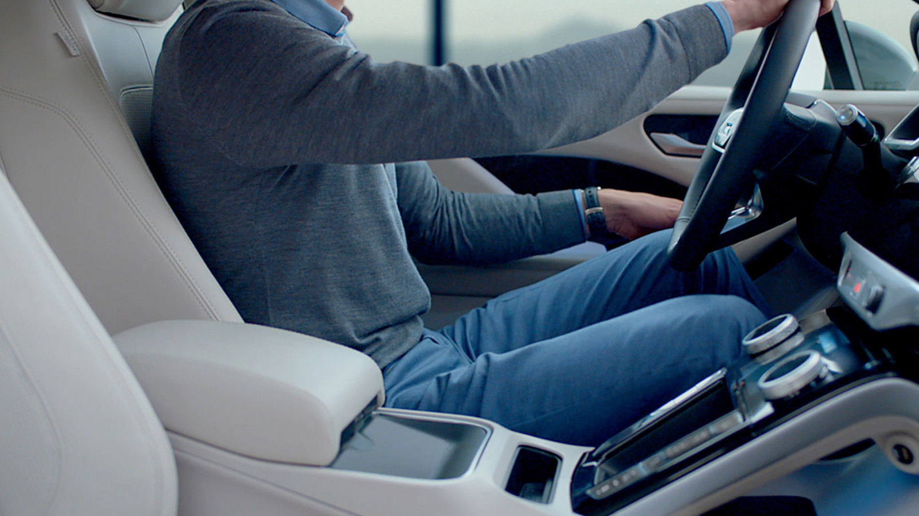 View Of Jaguar I-Pace Driver Seat Whilst Man Is Driving.