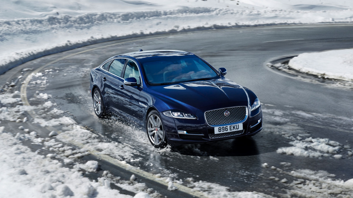 Jaguar XJ driving on snow.