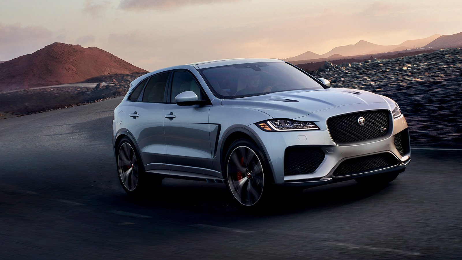 Silver F-PACE SVR driving in rural area.