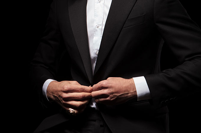 Man in black dinner suit.