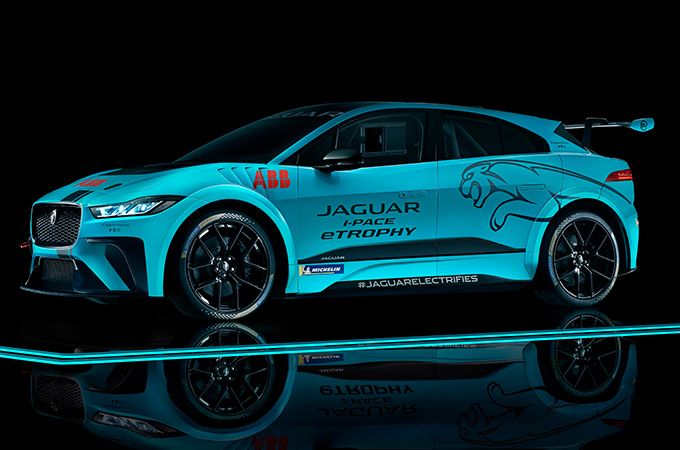 Jaguar IPace racing car with floor reflection.