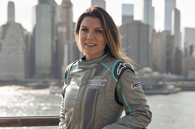 Jaguar racing driver in driving overalls.