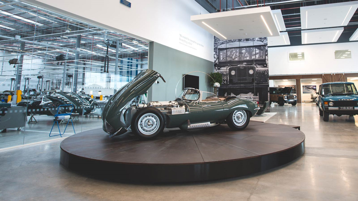 A Jaguar XKSS parked in a showroom.